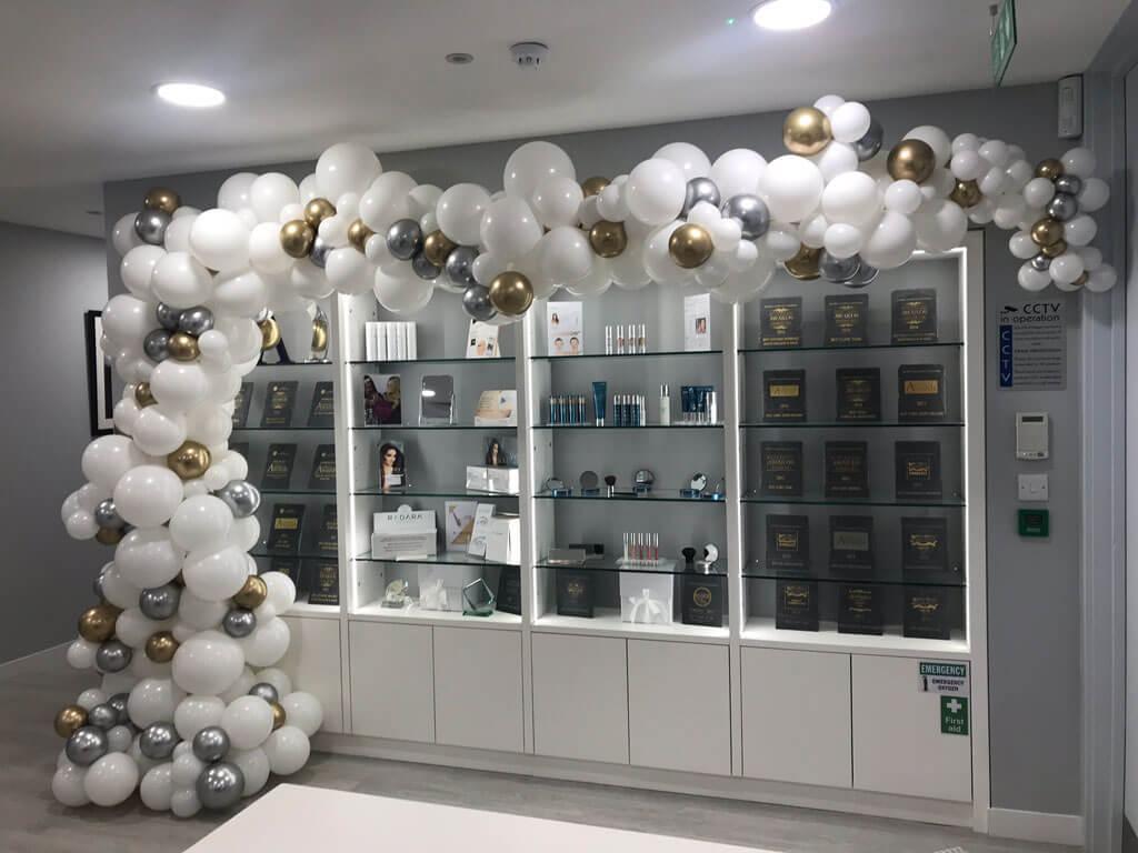 Farnham Health and Aesthetics asymmetrical organic balloon arch Airmagination Elstead Godalming Surrey
