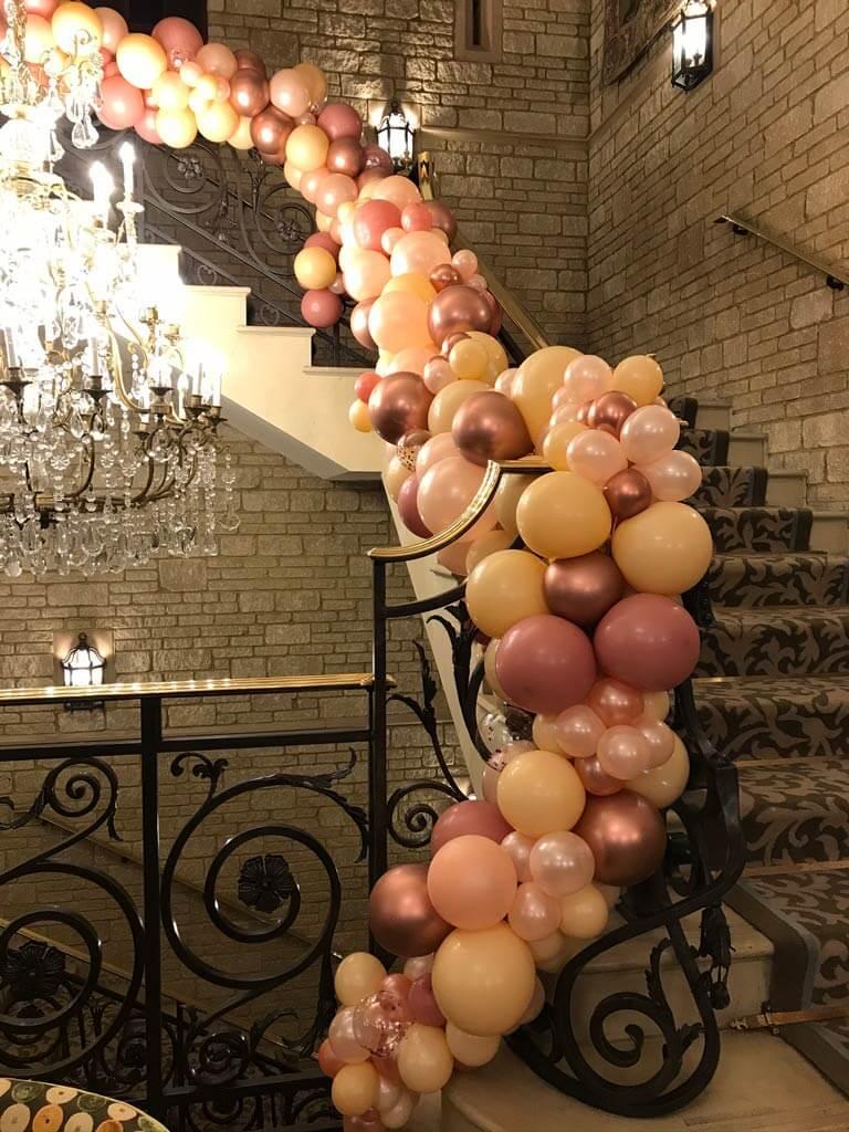 Pennyhill Park organic balloon staircase garland Airmagination Surrey 3