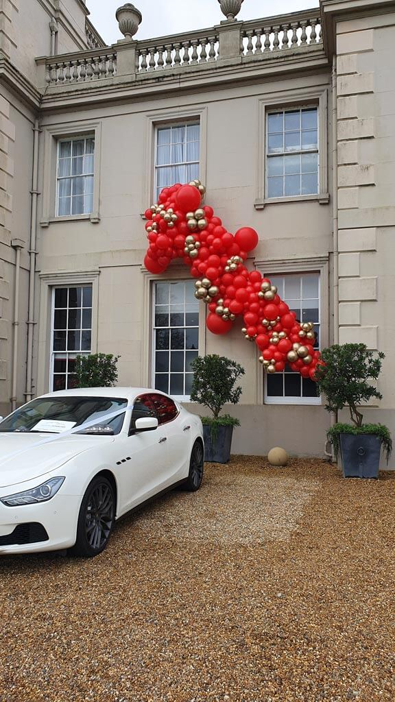 Wokefield Park Hotel organic garland spilling out of windows 3 Airmagination