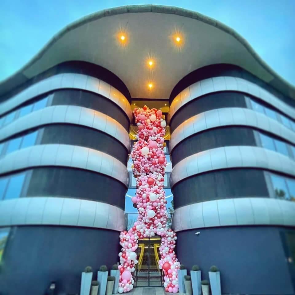 Airmagination Balloon Company Install Balloon Garland Tower Display at the Aviator Hotel