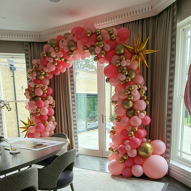 Organic balloon arch birthday party pink gold compressed