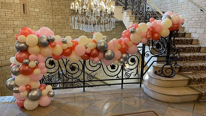 Organic balloons garland Pennyhill Park wedding compressed
