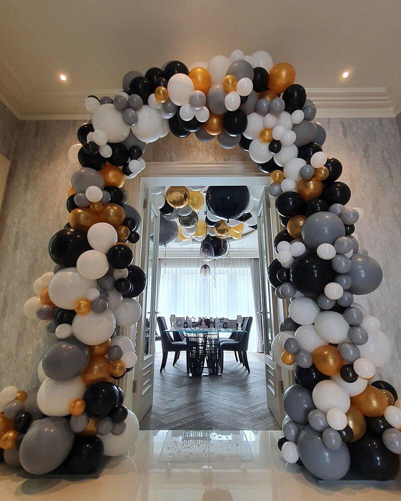 black white gold balloon arch