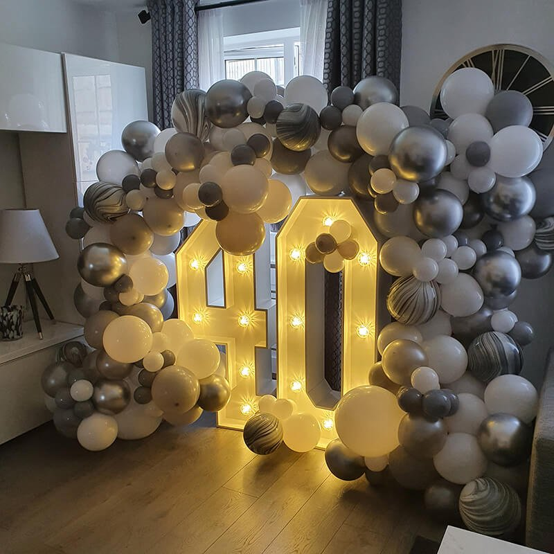 light up numbers with balloon garland