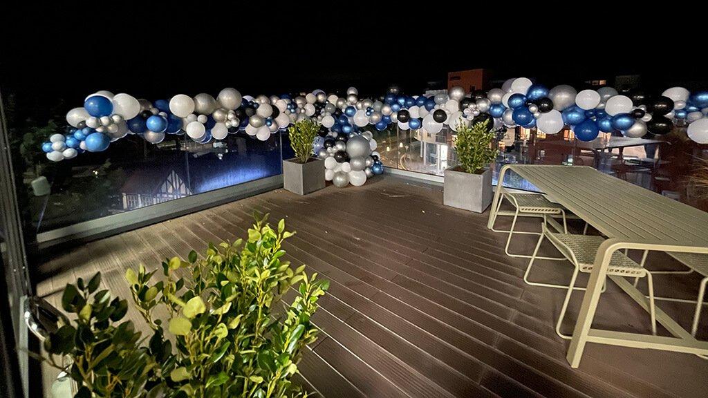 organic garland birthday on balcony